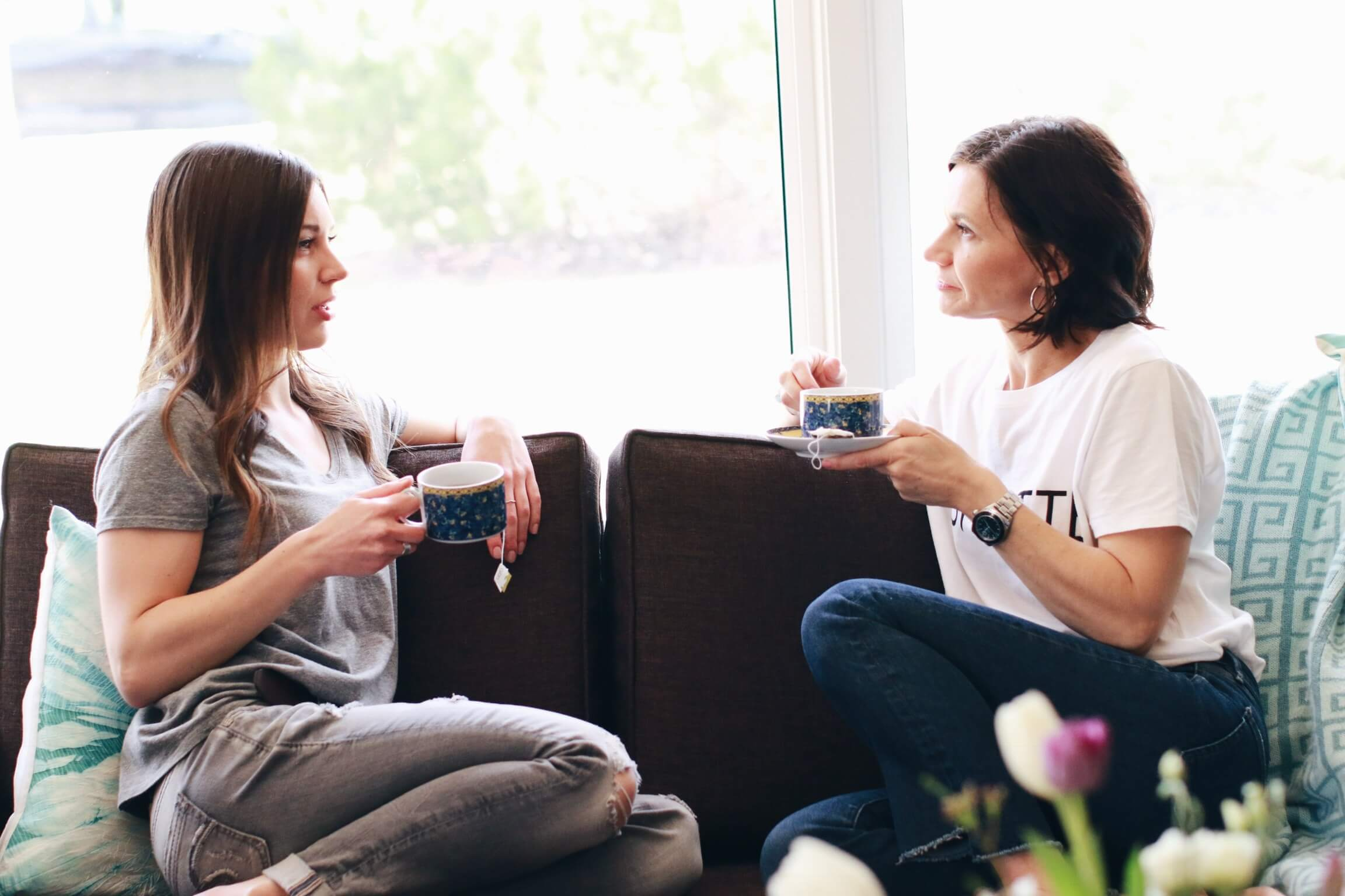Mother and daughter visit over tea