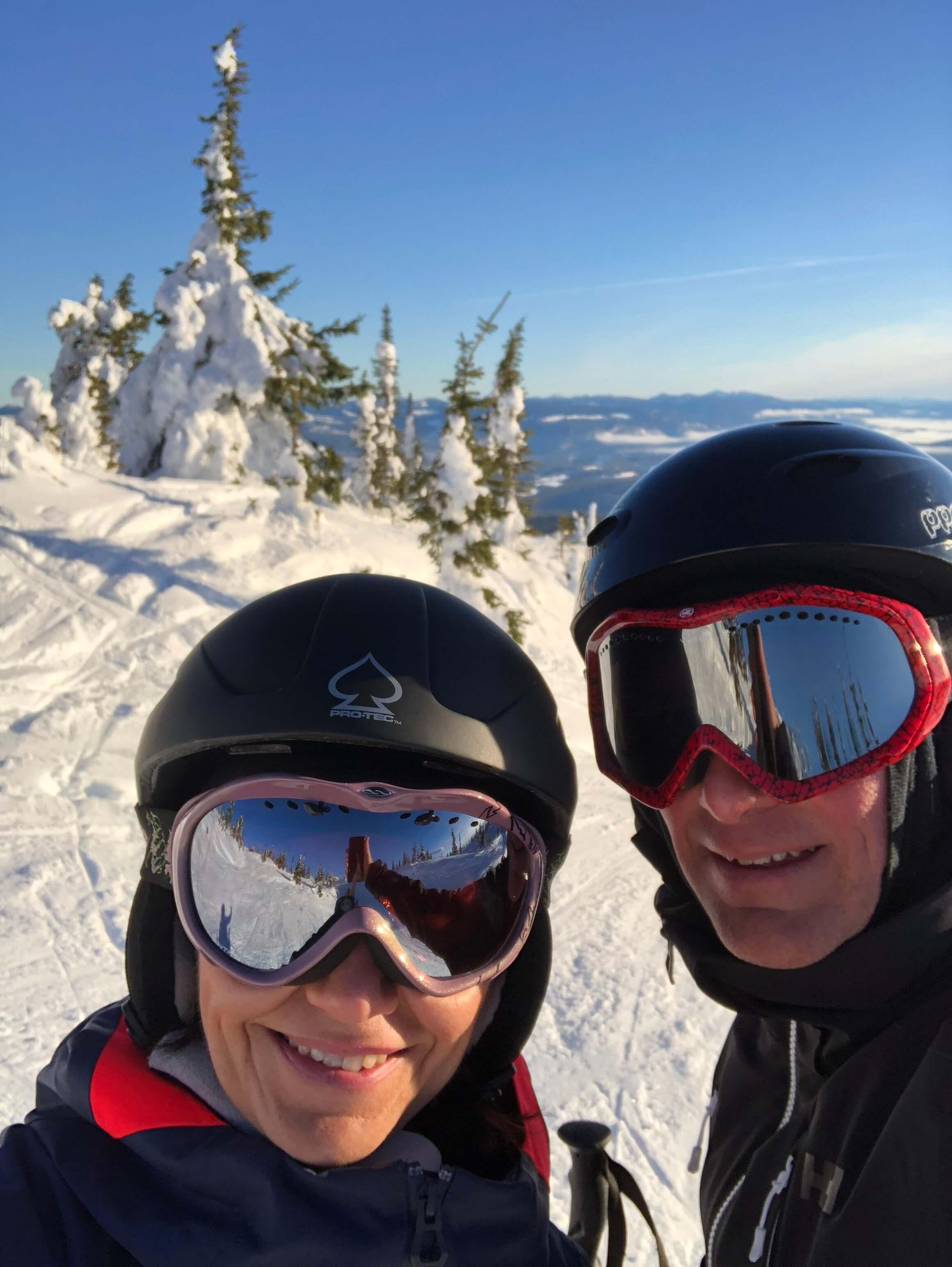 couple downhill skiing